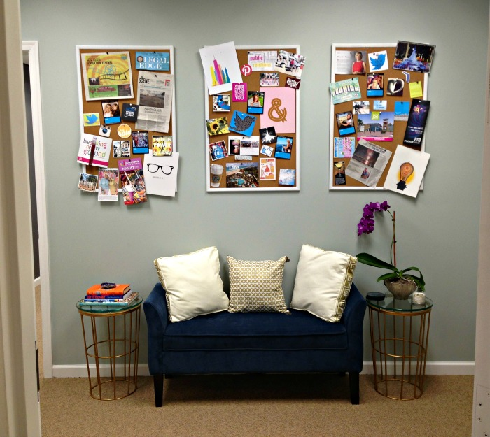 bulletin boards and blue couch