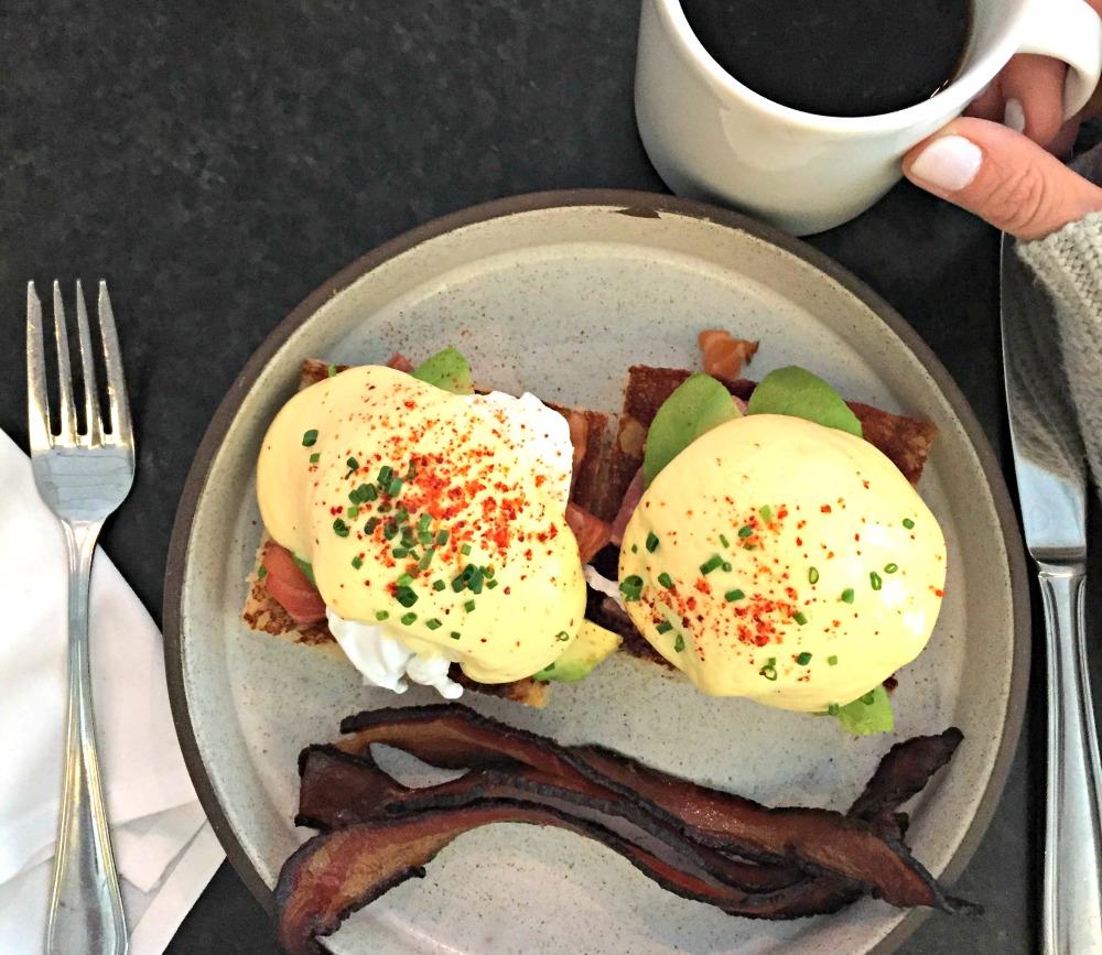 A happy egg benedict sandwich at Le Sel // hat to Eat, See & Do in Nashville