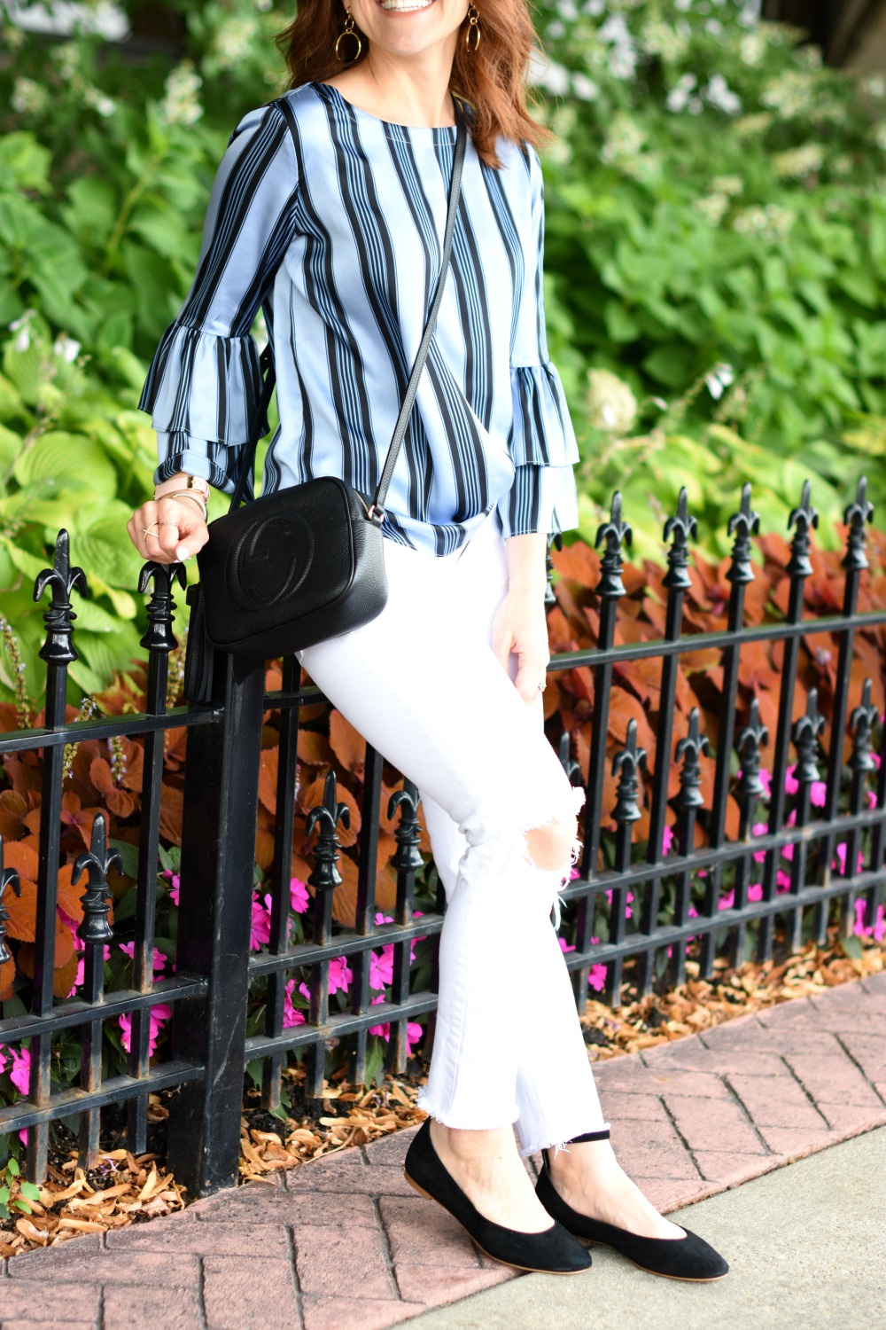 Statement sleeves with Gucci disco purse