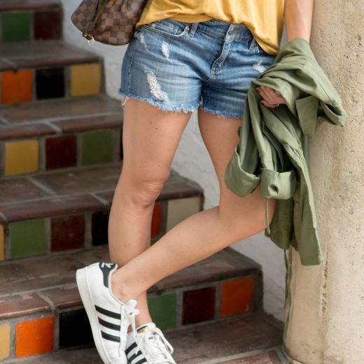 Fall style (even when it's hot out!) -- loving the army green jacket, mustard tee, denim and adidas // the modern savvy, a life & style blog
