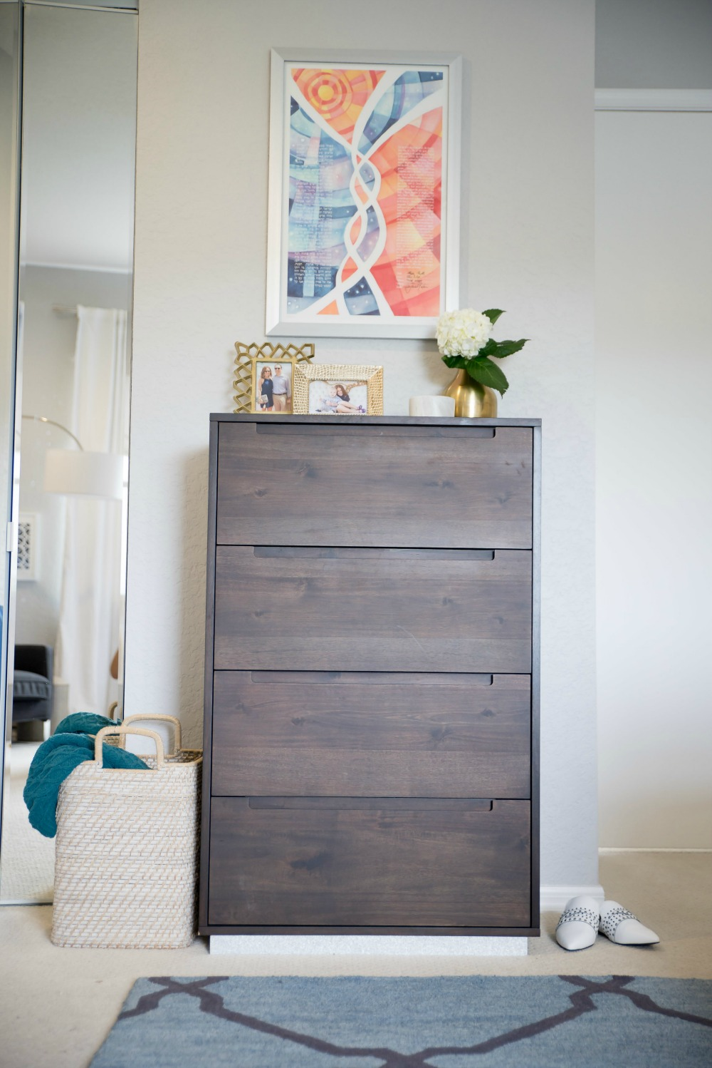 Master bedroom refresh -- bright and light master bedroom decor (before & after) with grey upholstered headboard by popular Florida style blogger The Modern Savvy