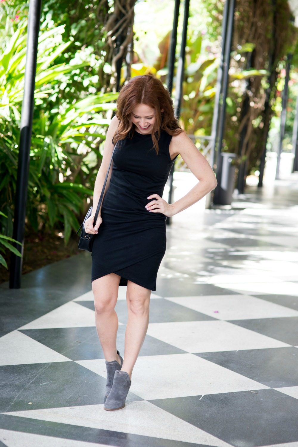 LBD and booties - the $56 Black Midi Dress Every Blogger Loves by popular Florida fashion blogger The Modern Savvy