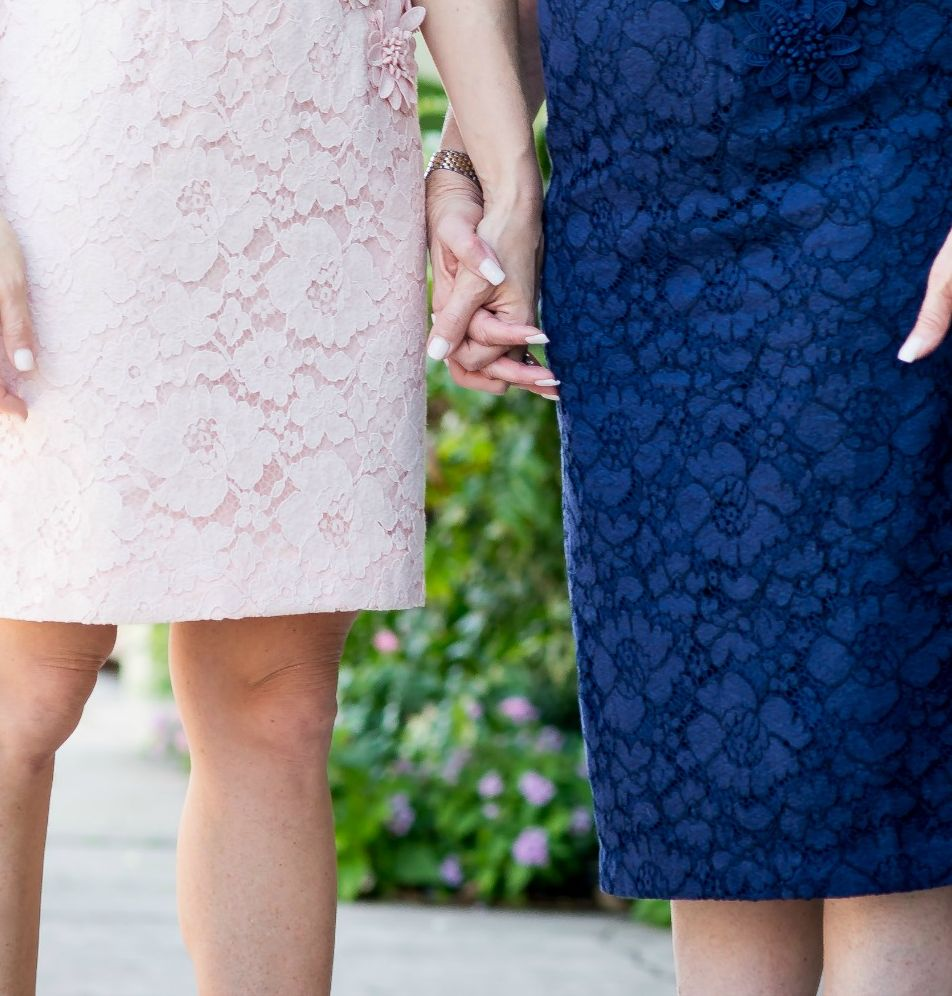 Mother daughter holding hands for Mother's Day // the modern savvy - Mother Daughter style: Lessons My Mother Taught Me by popular Florida lifestyle blogger, The Modern Savvy