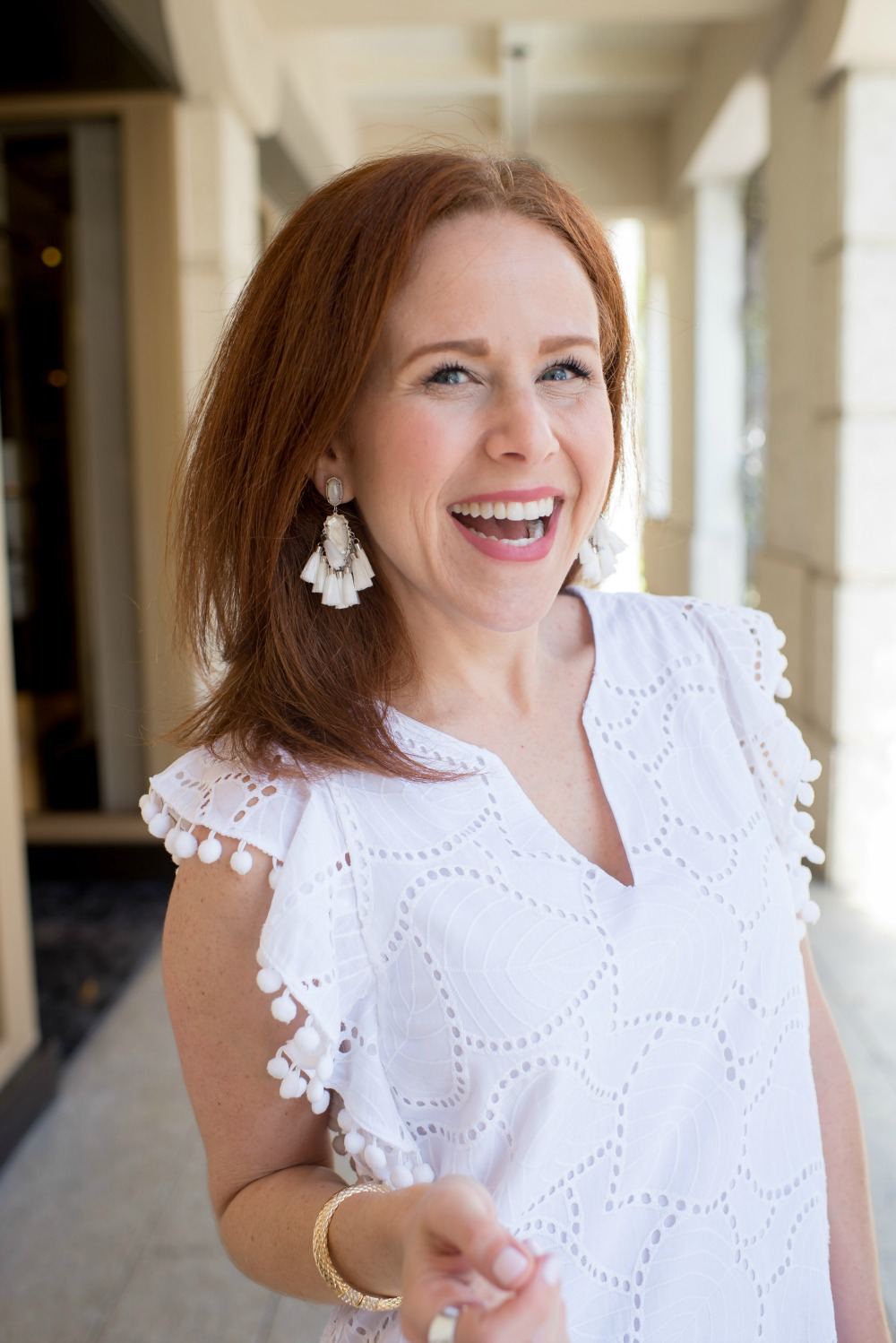 Redhead blogger, Alyson, of The Modern Savvy, styles a white pom pom dress for summer - The Little White Dress featured by popular Florida style blogger, The Modern Savvy