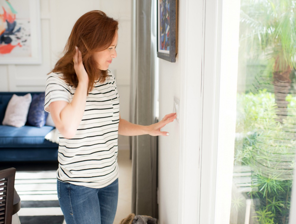 How to Lower Your Energy Bill: 12 Essential Tips featured by popular Florida life and style blogger The Modern Savvy