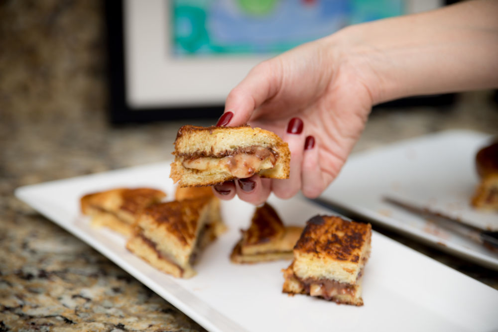 perfect for brunch in bite size pieces! #brunch #holiday #recipes #brunchrecipes | Castello Cheese | Foodie | Nutella & Raspberry Stuffed Grilled Cheese featured by top Florida lifestyle blog The Modern Savvy