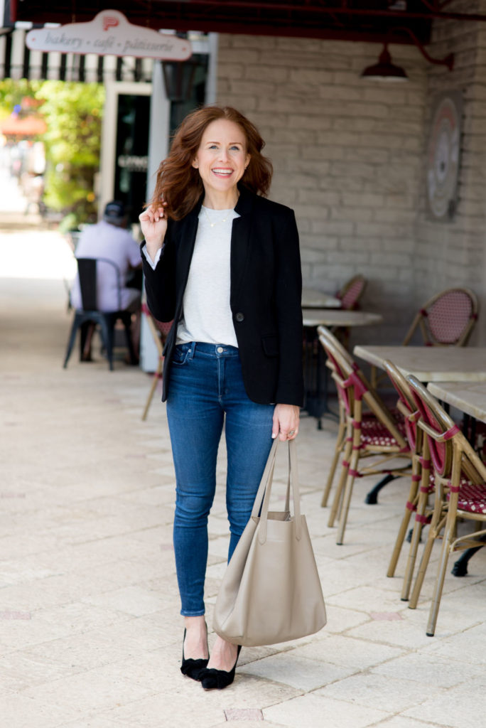 White Tee and Jeans featured by top US fashion blog The Modern Savvy; Image of a woman wearing Something Navy tee, Citizens for Humanity jeans, Nordstrom blazer and Shein shoes.