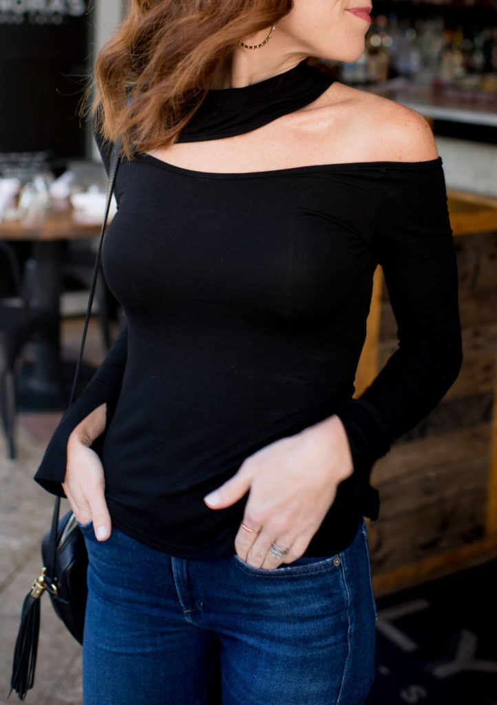 Black Top and Jeans Outfit featured by top US fashion blog The Modern Savvy; Image of a woman wearing an Amazon top, Citizens of Humanity jeans, Kendra Scott earrings, Sam Edelman heels and Gucci purse.