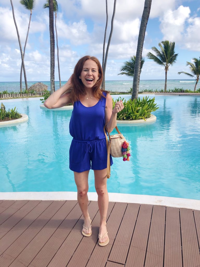 What to Wear in Punta Cana featured by top US fashion blog The Modern Savvy; Image of a woman wearing Gibson x Hi SugarPlum collection romper.