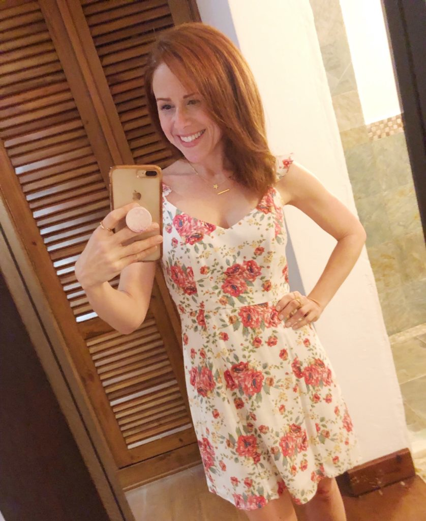 What to Wear in Punta Cana featured by top US fashion blog The Modern Savvy; Image of a woman wearing a Floral dress