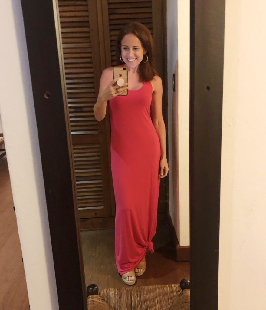 What to Wear in Punta Cana featured by top US fashion blog The Modern Savvy; Image of a woman wearing a pink Amazon maxi dress.