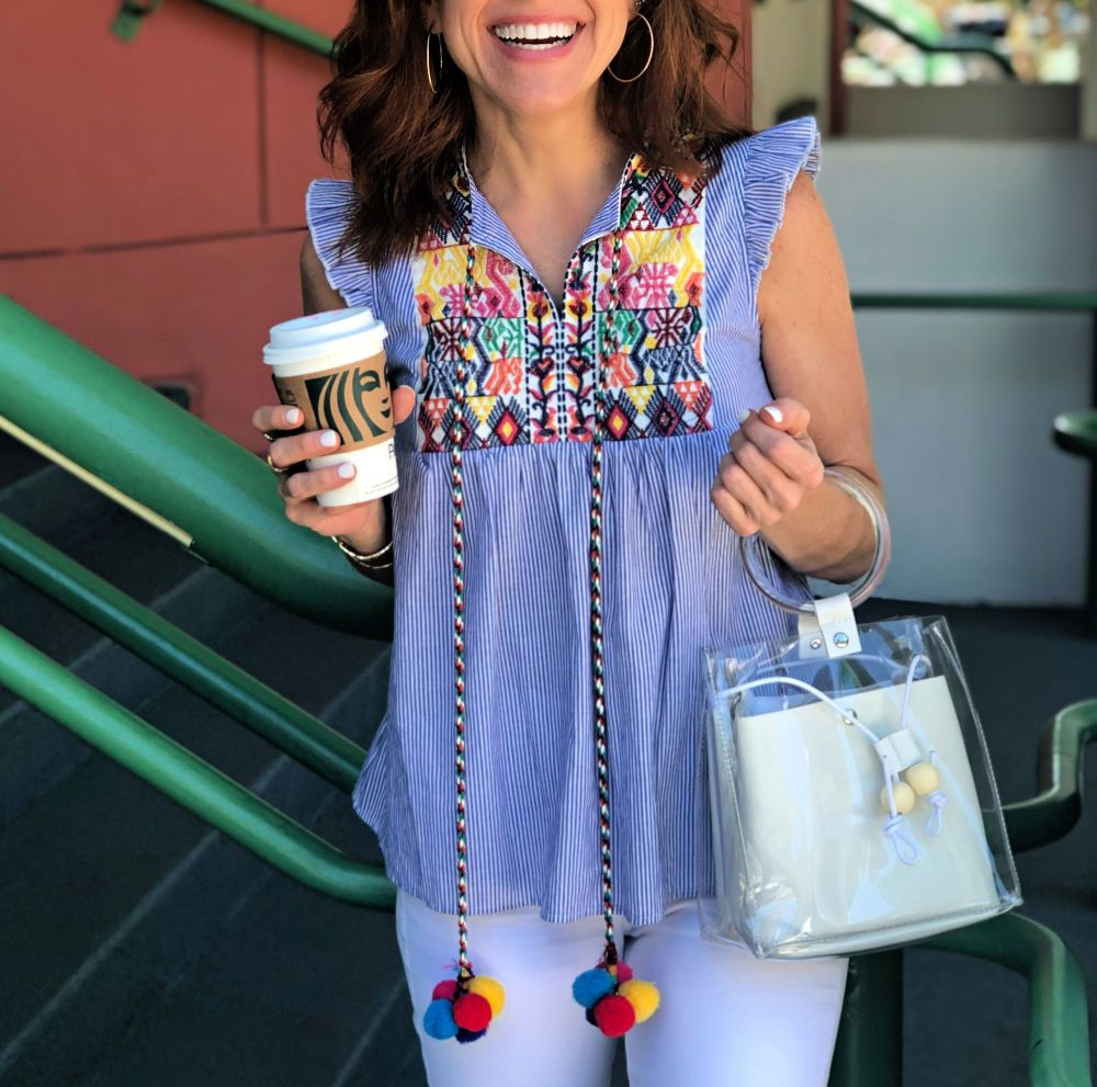 Current Favorites featured by top US life and style blog The Modern Savvy; Image of a woman wearing Amazon top and Amazon clear bag.