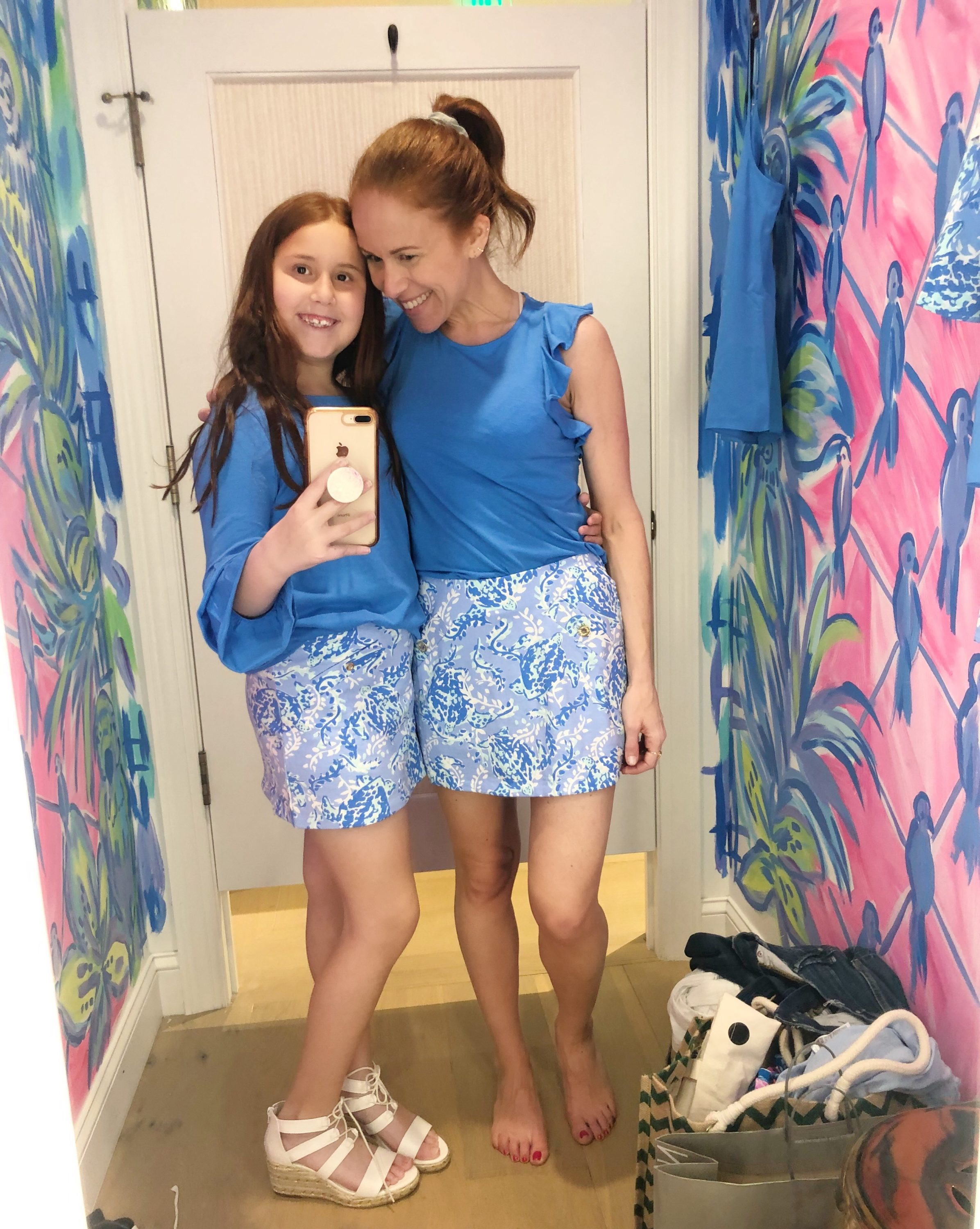 What to Get at the Lilly Pulitzer After Party Sale by popular Florida fashion blog, The Modern Savvy: image of a woman and her daughter wearing a Lilly Pulitzer GIRLS MAZIE TOP, Lilly Pulitzer GIRLS MINI MADISON SKORT, Lilly Pulitzer LANETTE TOP, and Lilly Pulitzer MADISON SKORT.