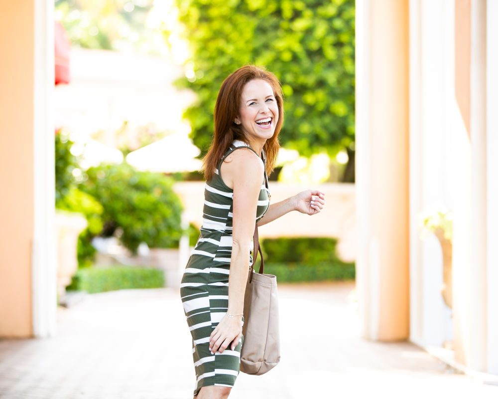 The $9 Striped Midi Dress by popular Florida fashion blog, The Modern Savvy: image of a woman walking outside and wearing a Wal-mart Say What? Juniors' Stripe Knit Button Front Midi Dress., Women's Circus by Sam Edelman Betty-2 Slide Sandals, and Time and Tru Emiko Tote.