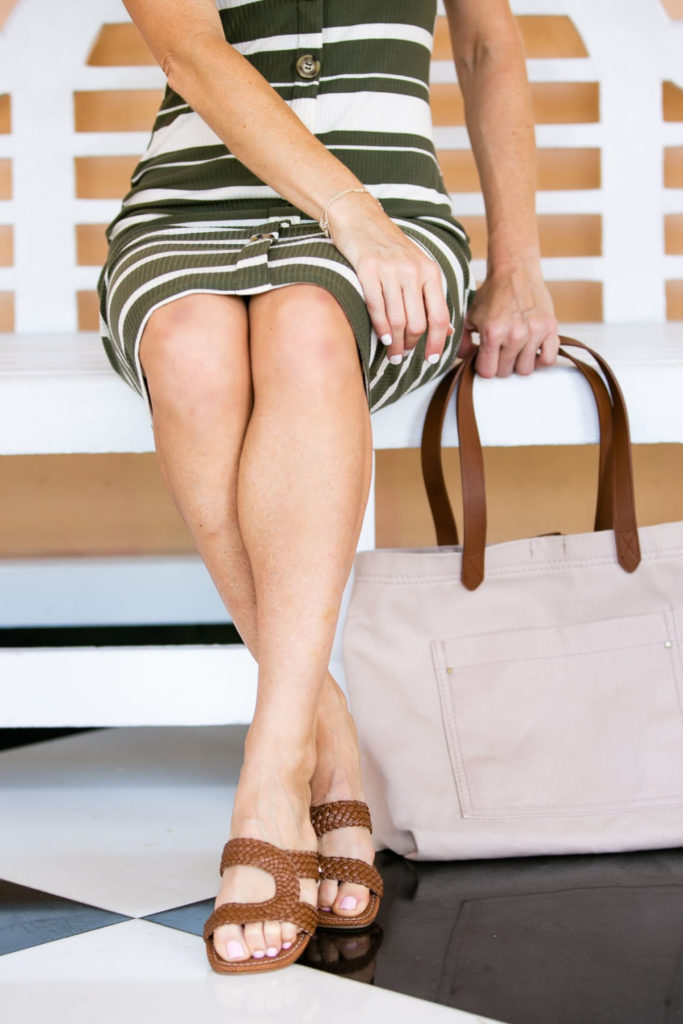 The $9 Striped Midi Dress by popular Florida fashion blog, The Modern Savvy: image of a woman sitting outside and wearing a Wal-mart Say What? Juniors' Stripe Knit Button Front Midi Dress, Women's Circus by Sam Edelman Betty-2 Slide Sandals, and Time and Tru Emiko Tote.