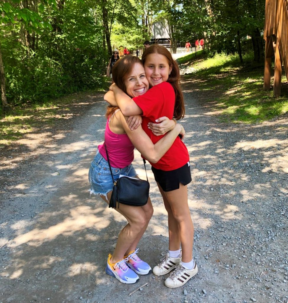 Alyson's Recent Favorites // July 2019 by popular Florida lifestyle blog: The Modern Savvy: image of a woman hugging her daughter outside and wearing a pair of Nike Air Max 270.