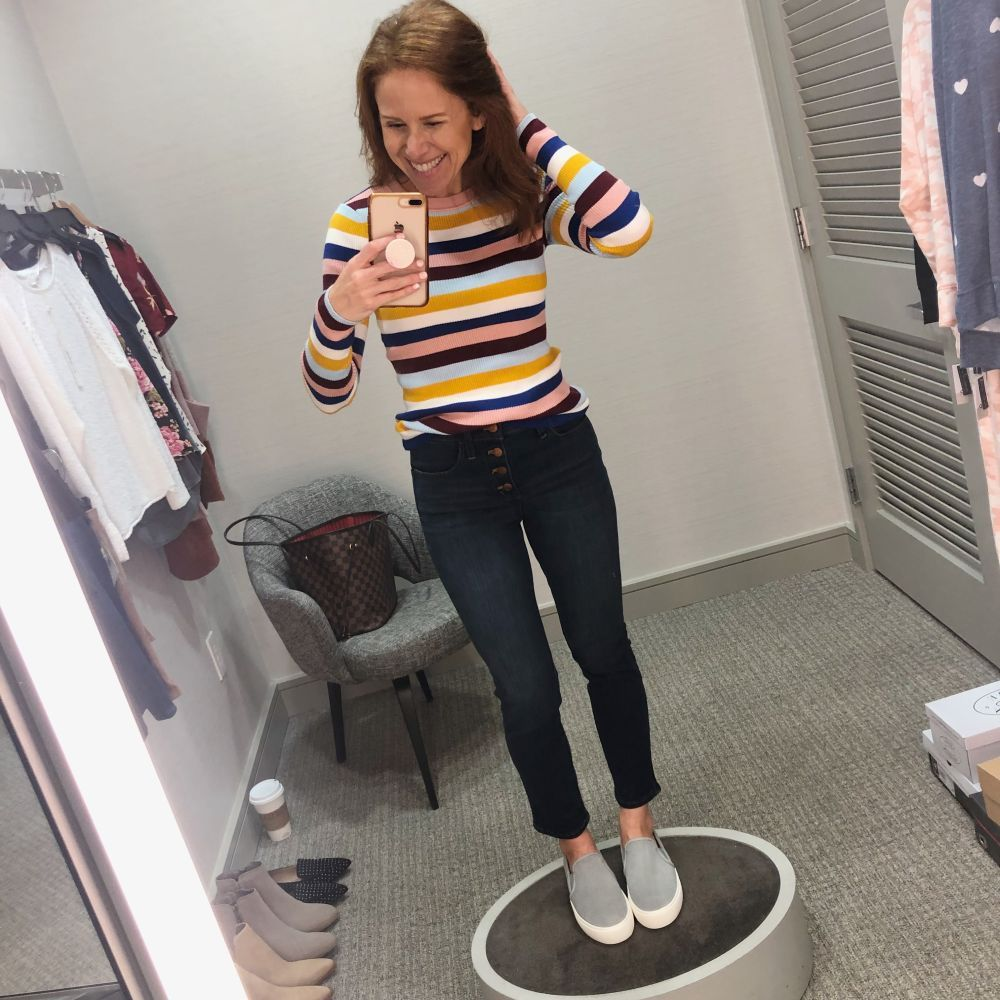 Nordstrom Anniversary Sale 2019: Fitting Room Try-On Session & My Favorite Under $100 finds! by popular Florida fashion blog, The Modern Savvy: image of woman inside a Nordstrom dressing room wearing a Halogen Ribbed Sweater, Ugg Sneakers, and Madewell 10-Inch High Waist Skinny Jeans: Button Front Edition
