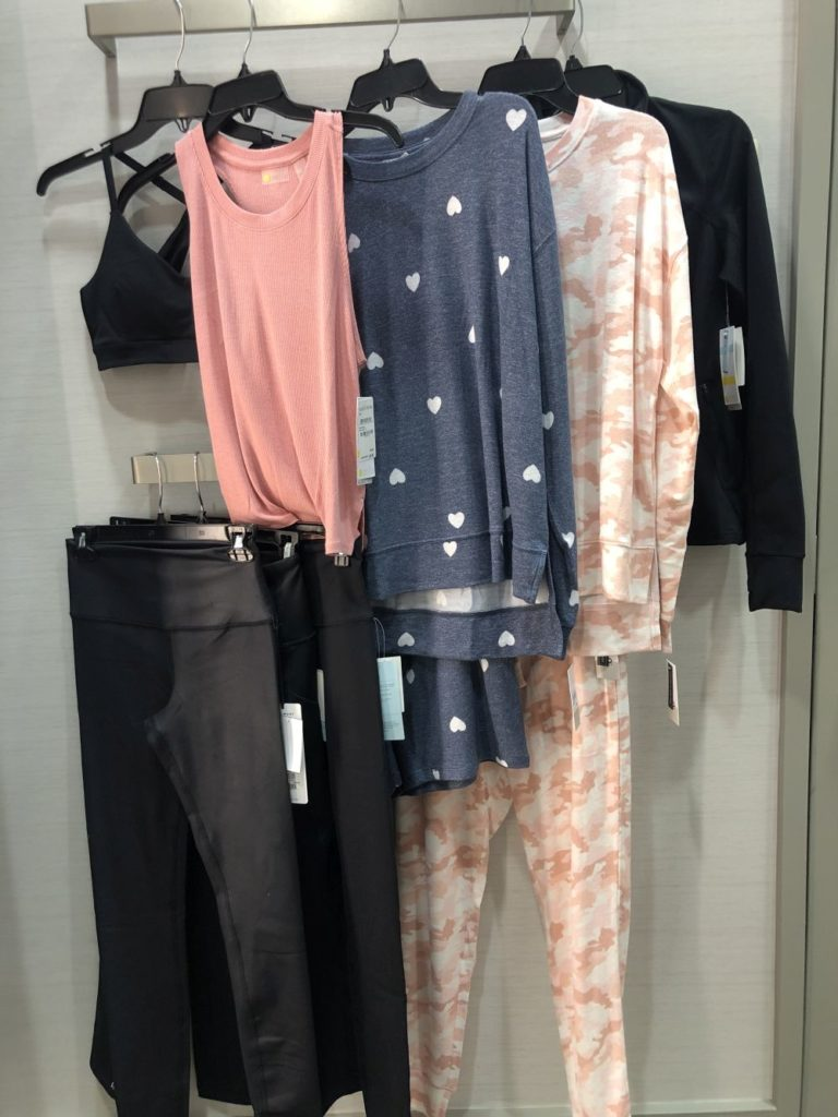 Nordstrom Anniversary Sale 2019: Fitting Room Try-On Session & My Favorite Under $100 finds! by popular Florida fashion blog, The Modern Savvy: image of lounge and athletic wear hanging on a clothing rack in a Nordstrom dressing room.