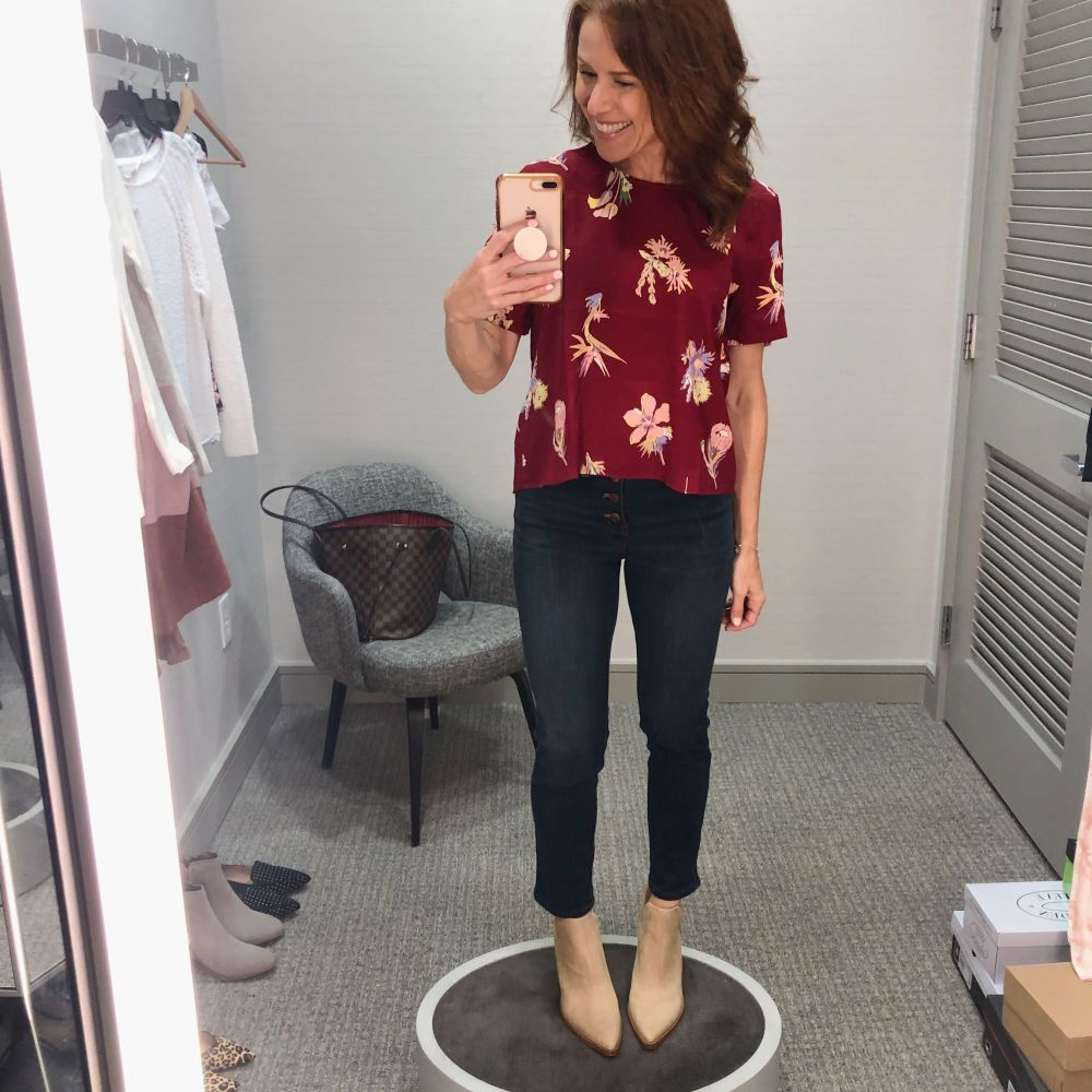 Nordstrom Anniversary Sale 2019: Fitting Room Try-On Session & My Favorite Under $100 finds! by popular Florida fashion blog, The Modern Savvy: image of woman inside a Nordstrom dressing room wearing a MADEWELL floral top, VINCE CAMUTO BOOTIES and Madewell 10-Inch High Waist Skinny Jeans: Button Front Edition.