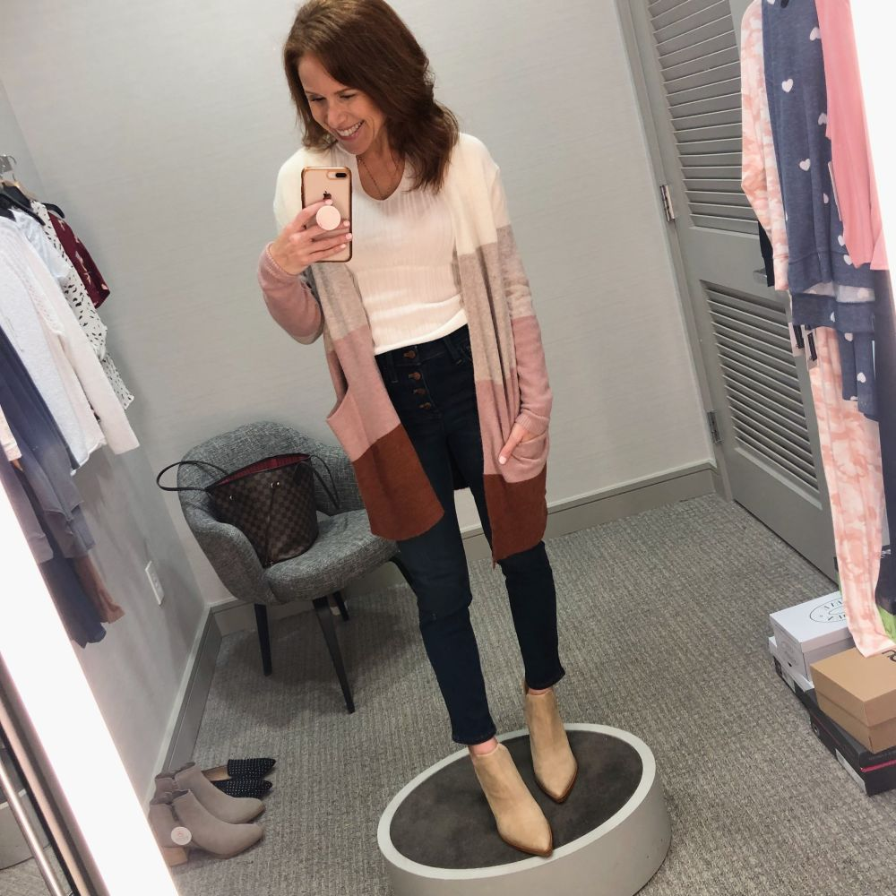 Nordstrom Anniversary Sale 2019: Fitting Room Try-On Session & My Favorite Under $100 finds! by popular Florida fashion blog, The Modern Savvy: image of woman inside a Nordstrom dressing room wearing a MADEWELL RYDER CARDIGAN, VINCE CAMUTO BOOTIES and Madewell 10-Inch High Waist Skinny Jeans: Button Front Edition.