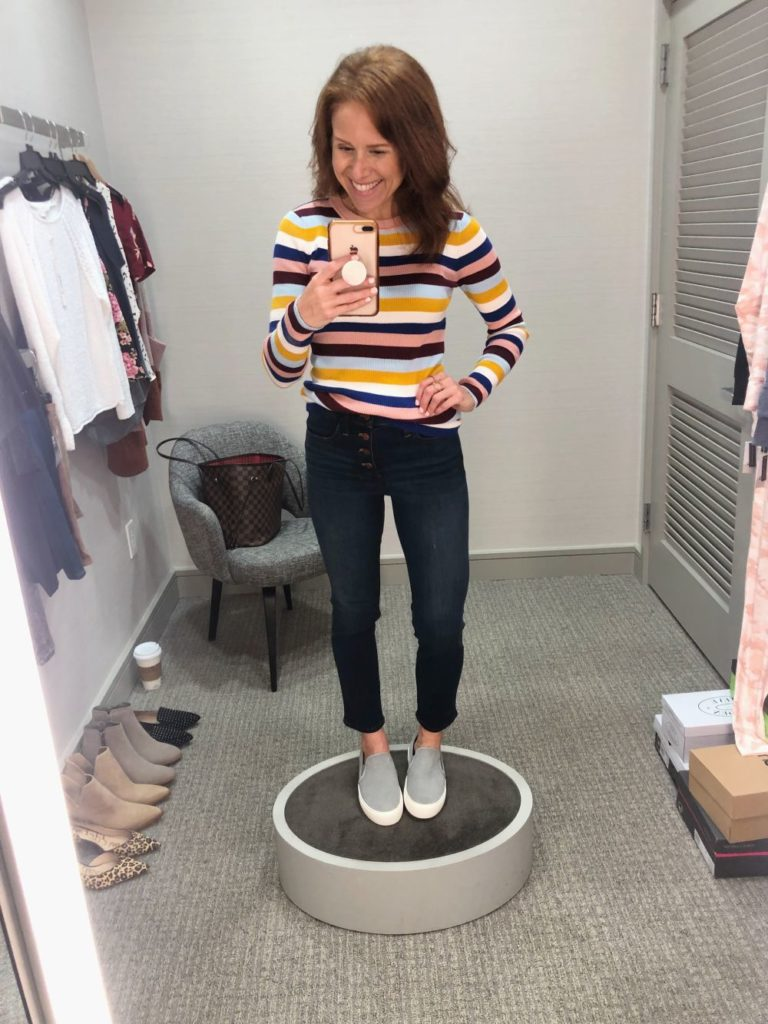 Nordstrom Anniversary Sale 2019: Fitting Room Try-On Session & My Favorite Under $100 finds! by popular Florida fashion blog, The Modern Savvy: image of woman inside a Nordstrom dressing room wearing a Halogen Ribbed Sweater, Ugg Sneakers, and Madewell 10-Inch High Waist Skinny Jeans: Button Front Edition.