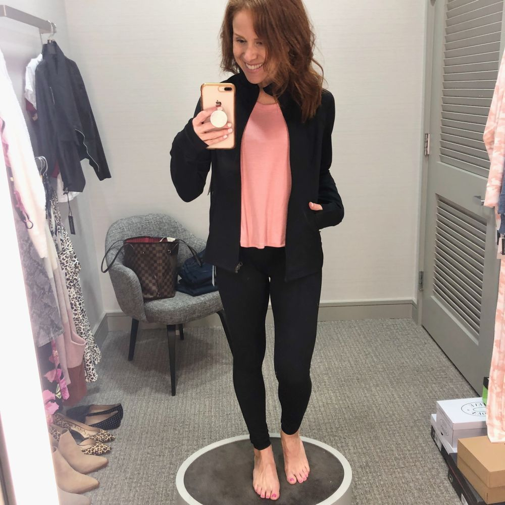 Nordstrom Anniversary Sale 2019: Fitting Room Try-On Session & My Favorite Under $100 finds! by popular Florida fashion blog, The Modern Savvy: image of woman inside a Nordstrom dressing room wearing a Zella Live In Jacket, Zella Splits Ribbed Tank, Zella bra, and Zella Live In High Waist Leggings.