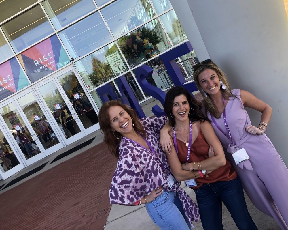 Alyson's Recent Favorites // July 2019 by popular Florida lifestyle blog: The Modern Savvy: image of a woman and two friends standing outside of a Rise conference.