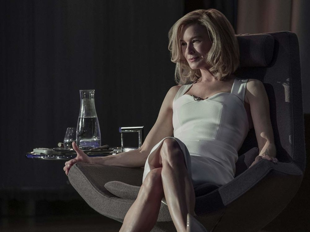 Alyson's Recent Favorites // July 2019 by popular Florida lifestyle blog: The Modern Savvy: image of Rene Zellweger wearing a white dress and sitting in a swivel chair.