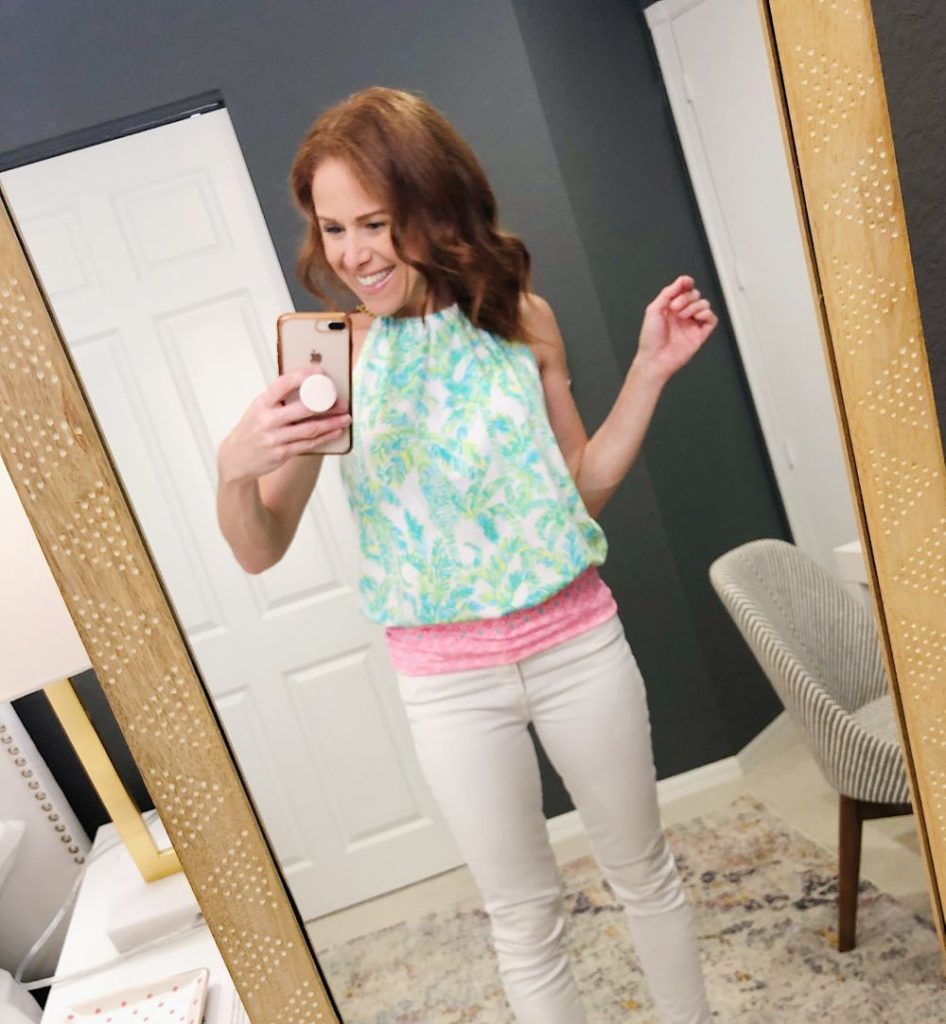 What to Get at the Lilly Pulitzer After Party Sale by popular Florida fashion blog, The Modern Savvy: image of a woman wearing a Lilly Pulitzer BOWEN HALTER TOP.