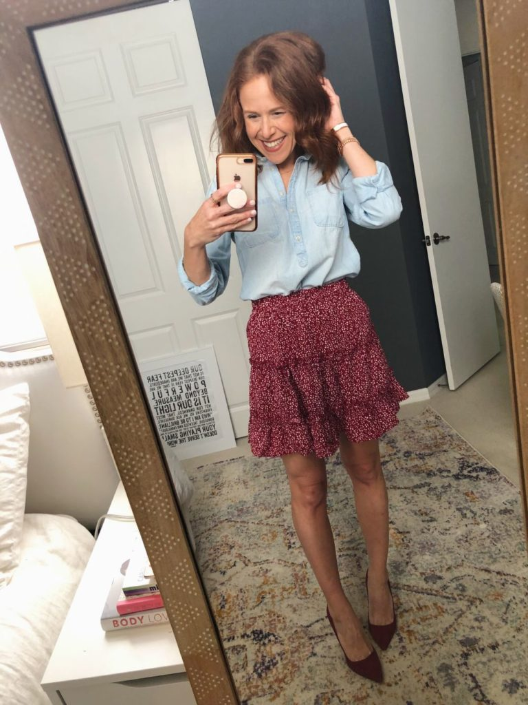 Five Ways to Wear for Fall: The Cutest Under $20 Amazon Skirt by popular Florida fashion blog, The Modern Savvy: image of a woman wearing a Amazon Salamola Women's Leopard Asymmetrical Ruffles High Waist Printed Cute Casual Mini Skirt, denim pullover, and heels.