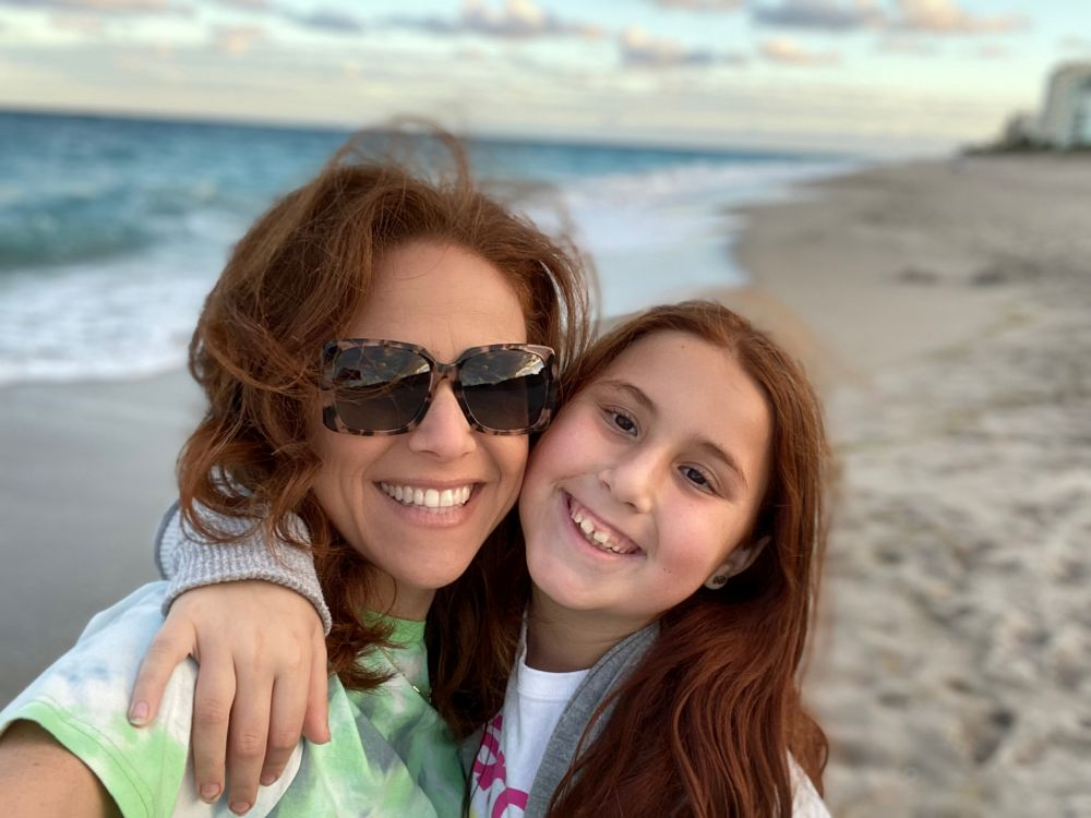 When the Little Moments in Life Are Really the Big Moments by popular Florida life and style blog, The Modern Savvy: image of a mom and daughter standing together on the beach.
