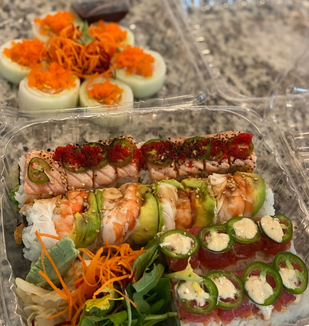 How to Feel Happy Again by popular Florida lifestyle blog, The Modern Savvy: image of takeout sushi.
